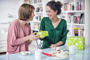 Girlfriends exchanging presents