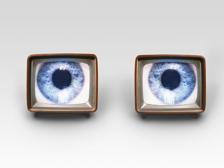 Two old fashioned TV sets with blue eyes