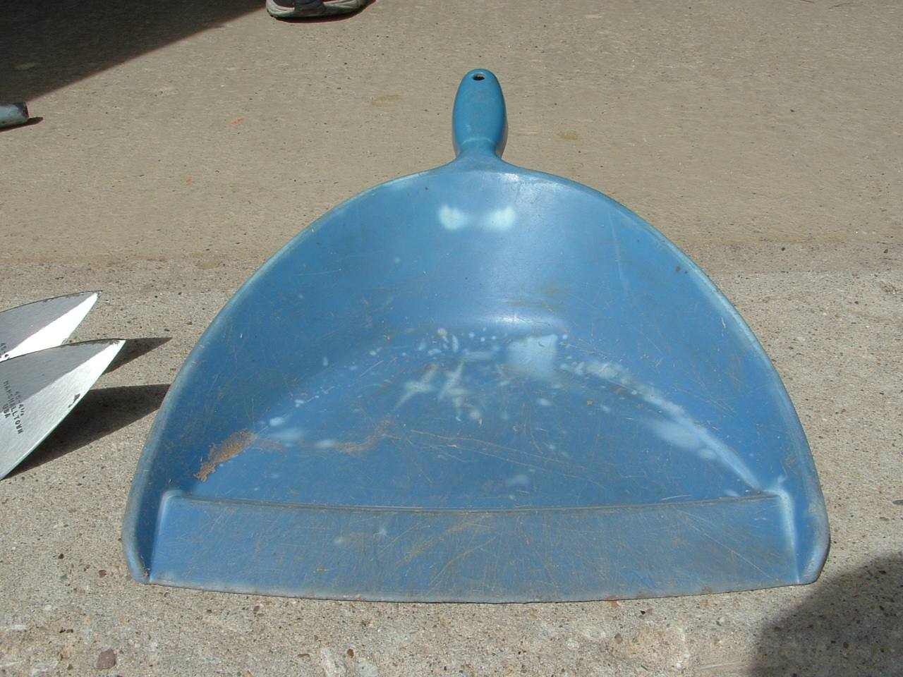 A dust pan, like the coal scoop, can come in very handy for removing excavated soil.