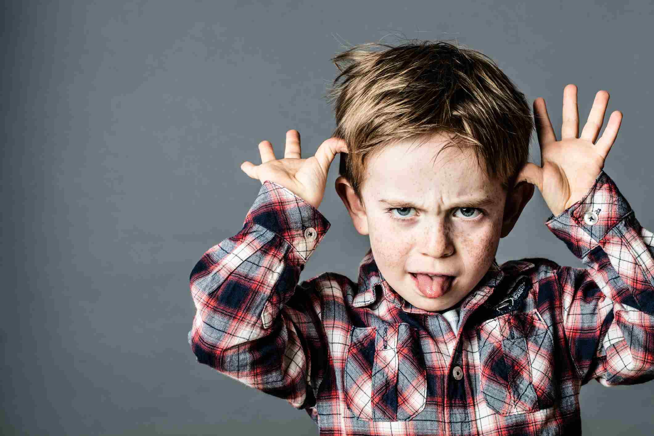 angry little brat enjoying making a grimace for misbehavior