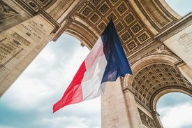 French flag under an archway