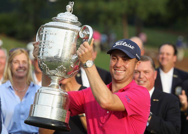 2017 PGA Championship winner Justin Thomas holds the Wanamaker Trophy aloft.