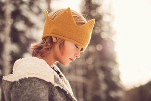 young boy wearin ga crown