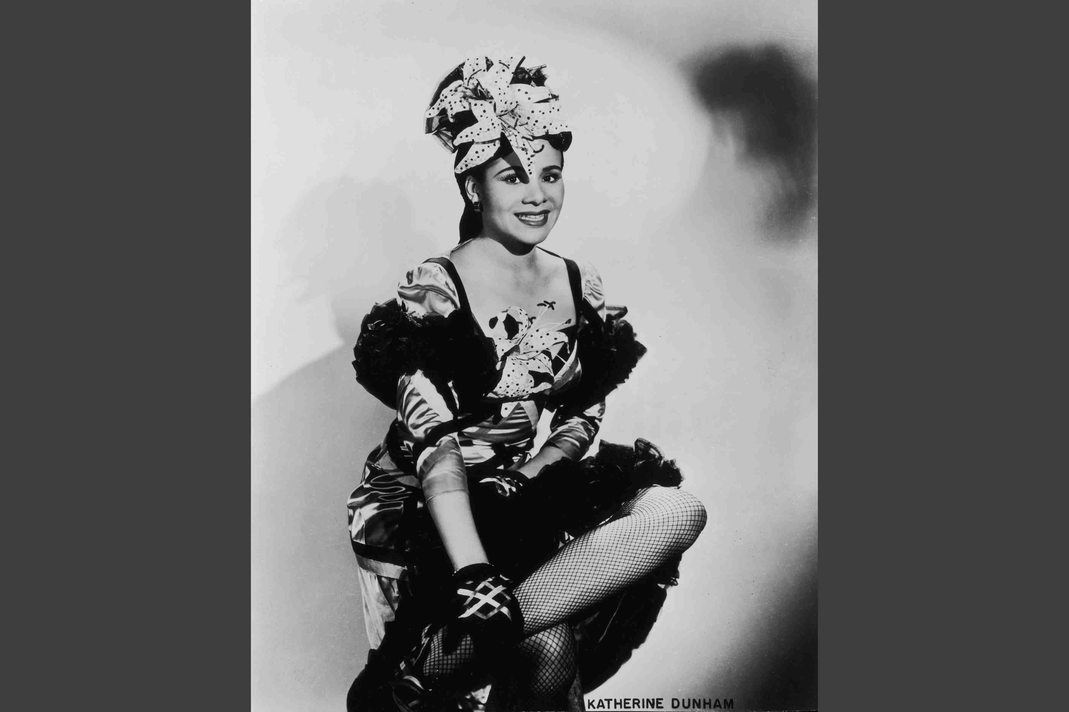 Katherine Dunham about 1945, wearing dance costume with ruffle tufts and artificial orchids