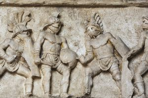 Bas relief of gladiators fighting in Italy
