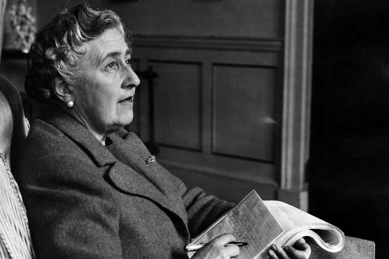 Dame Agatha Christie writing in a notebook in 1946​