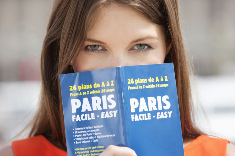 woman holding map of paris