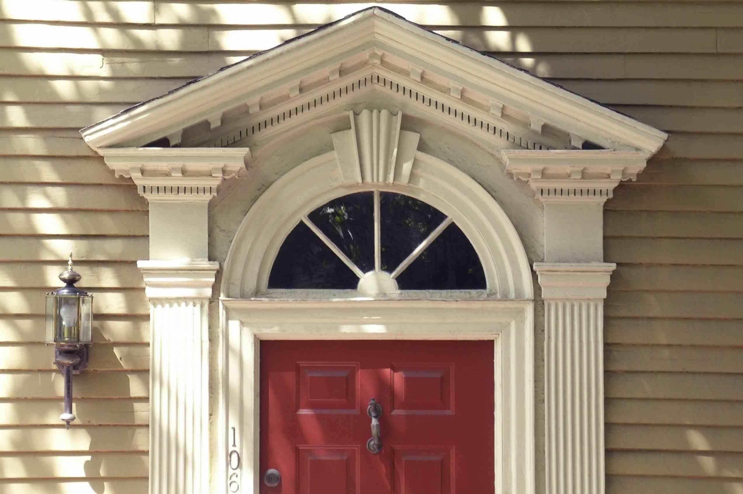 front door detail, open pediment, fanlight window, pilaster on either side of red door