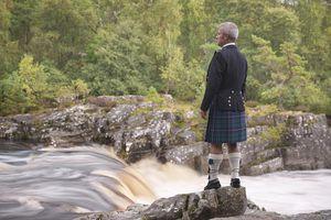 Man in kilt by river
