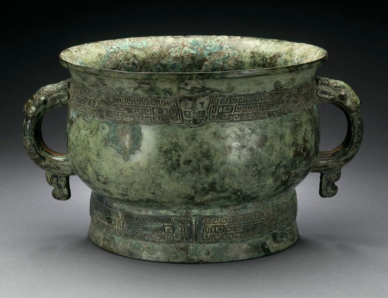 ancient ritual grain server with dragon handles