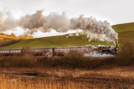 Heritage Steam Train Passing By Landscape Against Sky