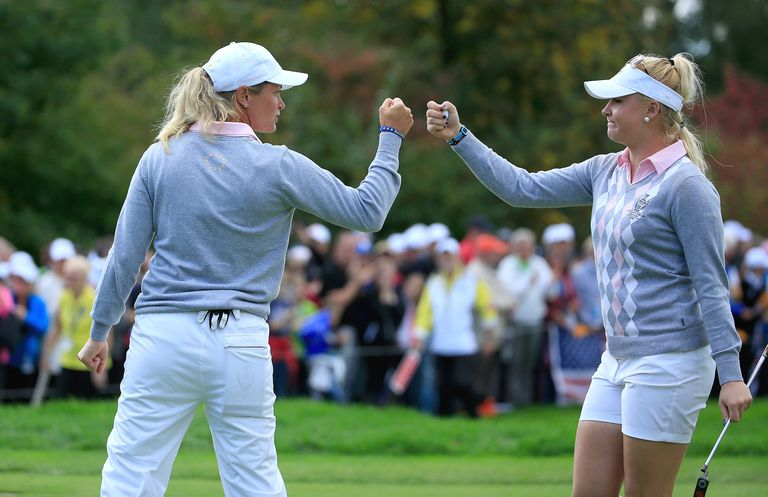 Charley Hull (r) of the European Team celebrates with her partner Suzann Pettersen after Hull had won the 16th hole in their match against Paula Creamer and Morgan Pressel by 1 hole during the morning foursomes matches in the 2015 Solheim Cup at St Leon-Rot Golf Club