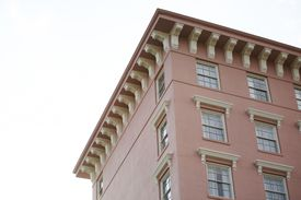 Flat roof, overhang, many corbels as ornamentation