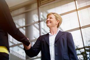 Businesswomen greeting a client