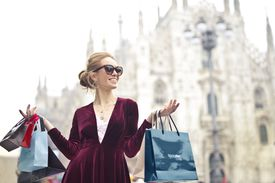 Woman with shopping bags on a sunny day.