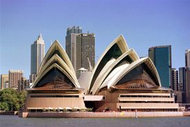 the front of the Sydney Opera House like two groups of 3 triangular white shells, one on top of another like humping shells