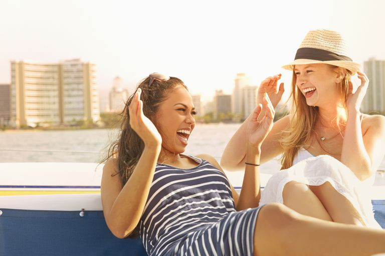 Women laughing on a boat