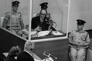 Adolf Eichmann in a glass booth during his trial