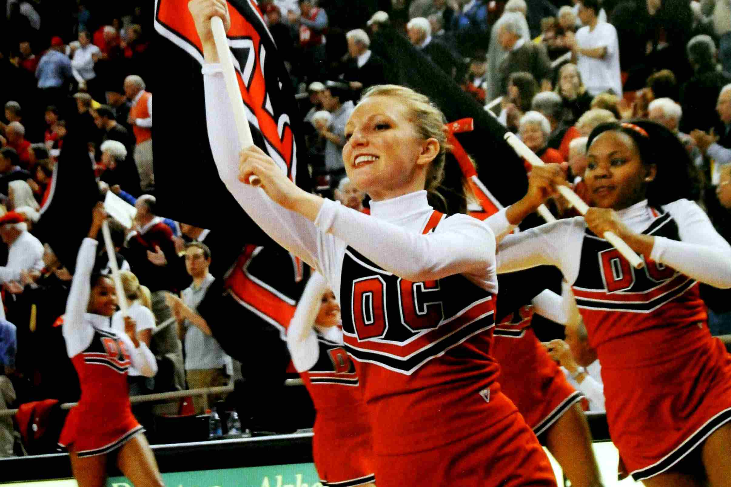 Davidson College cheerleaders perform a flag routine