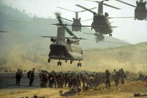 Color photograph of helicopters and soldiers during the Battle of Khe Sanh, Vietnam War.