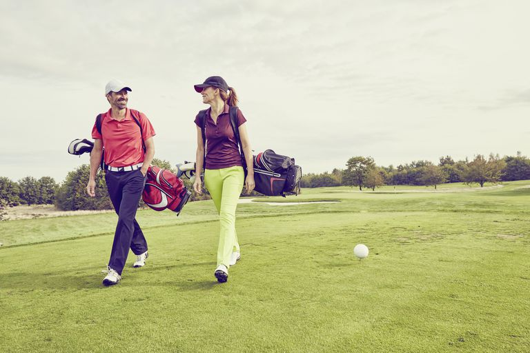 Two golfers walking off the teeing ground