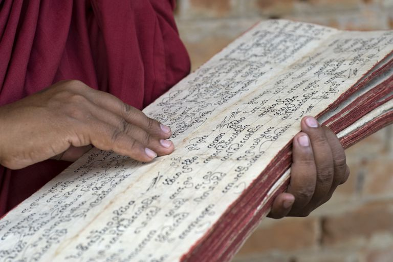 Mayanmar; Scriptures Being Read By A Buddhist Monk