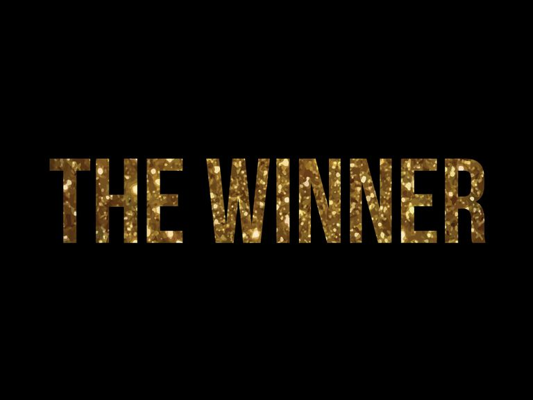 "The words ""The Winner"" in golld glitter"