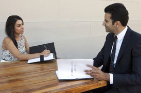 Woman interviewing a man for a job