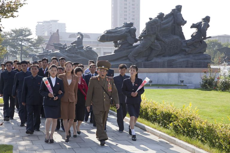 North Korea, Pyongyang, Veteran of Korean War leads visitors on guided tour of Victorious Fatherland Liberation Museum
