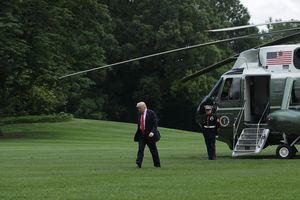 President Trump walks across the South Lawn from a helicopter in June 2017