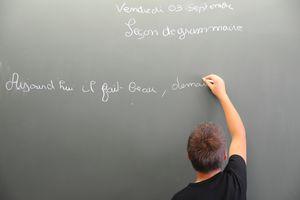 French teacher writing the phrase