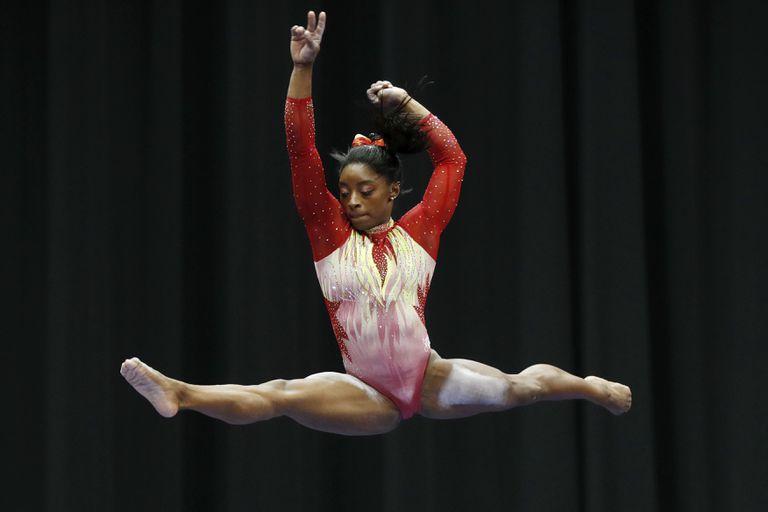 Simone Biles performing gymnastics.