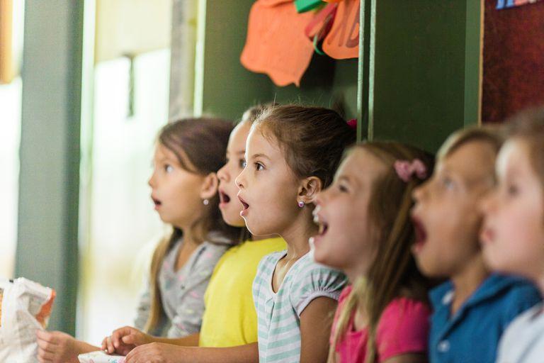 Group of children singing in school