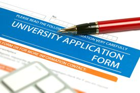 A blank university application form and a red pen