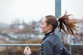 A woman running through the city.