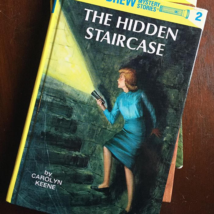 3 Nancy Drew books in a stack on a table