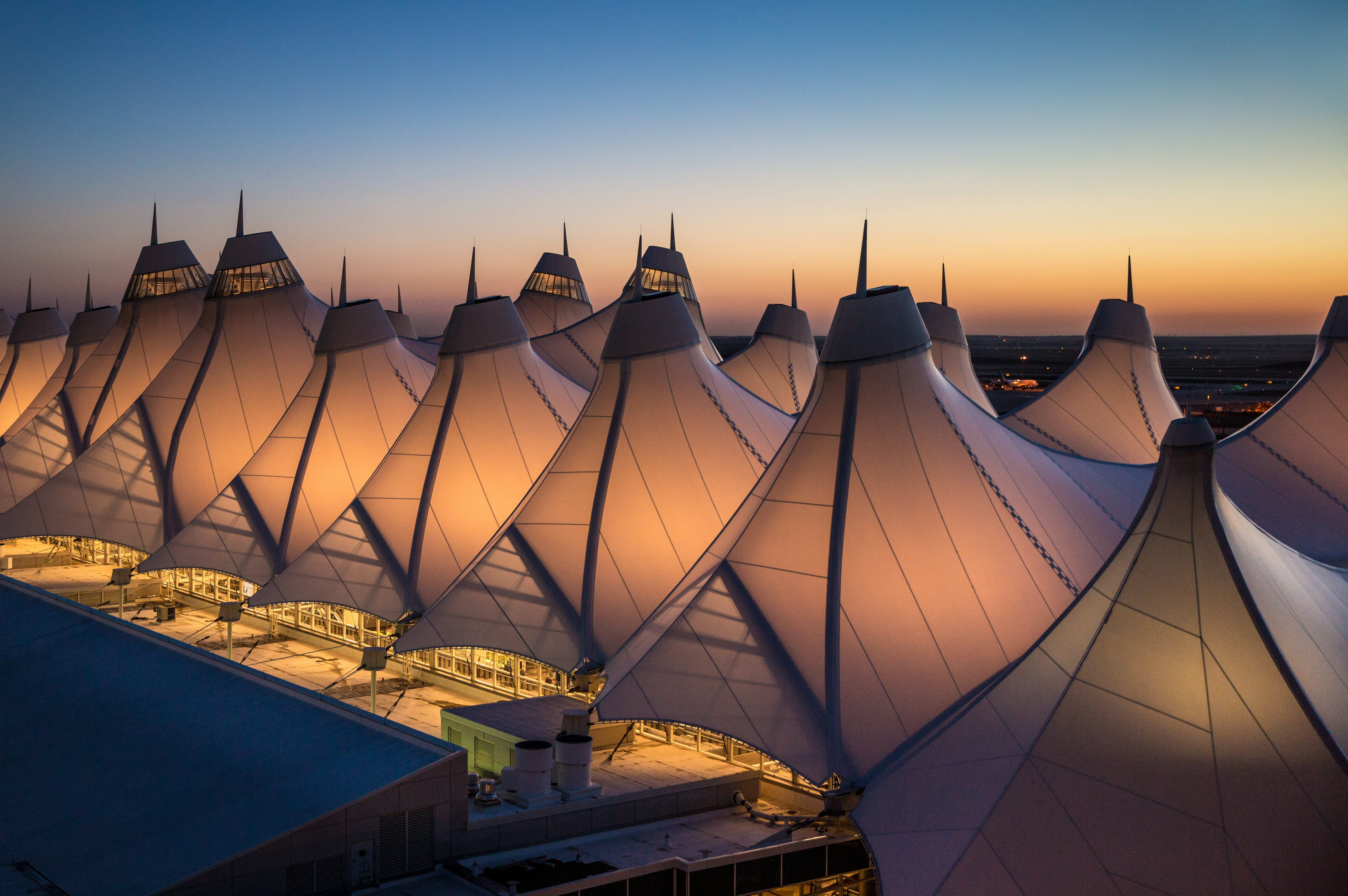 The unusual fabric-covered tent (or teepee) construction of the main airport terminal, designed to be reflective of the nearby snow-capped Rocky Mountains