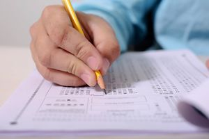 A close up view of a person taking the SATs.