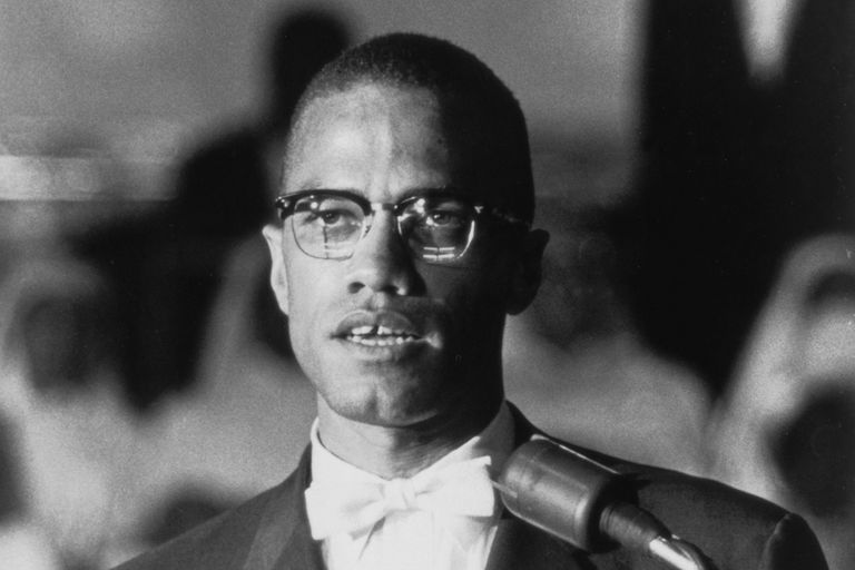 American political activist and radical civil rights leader Malcolm X (1925 - 1965) speaks at a podium during a Nation of Islam rally in Washington DC, circa 1963.