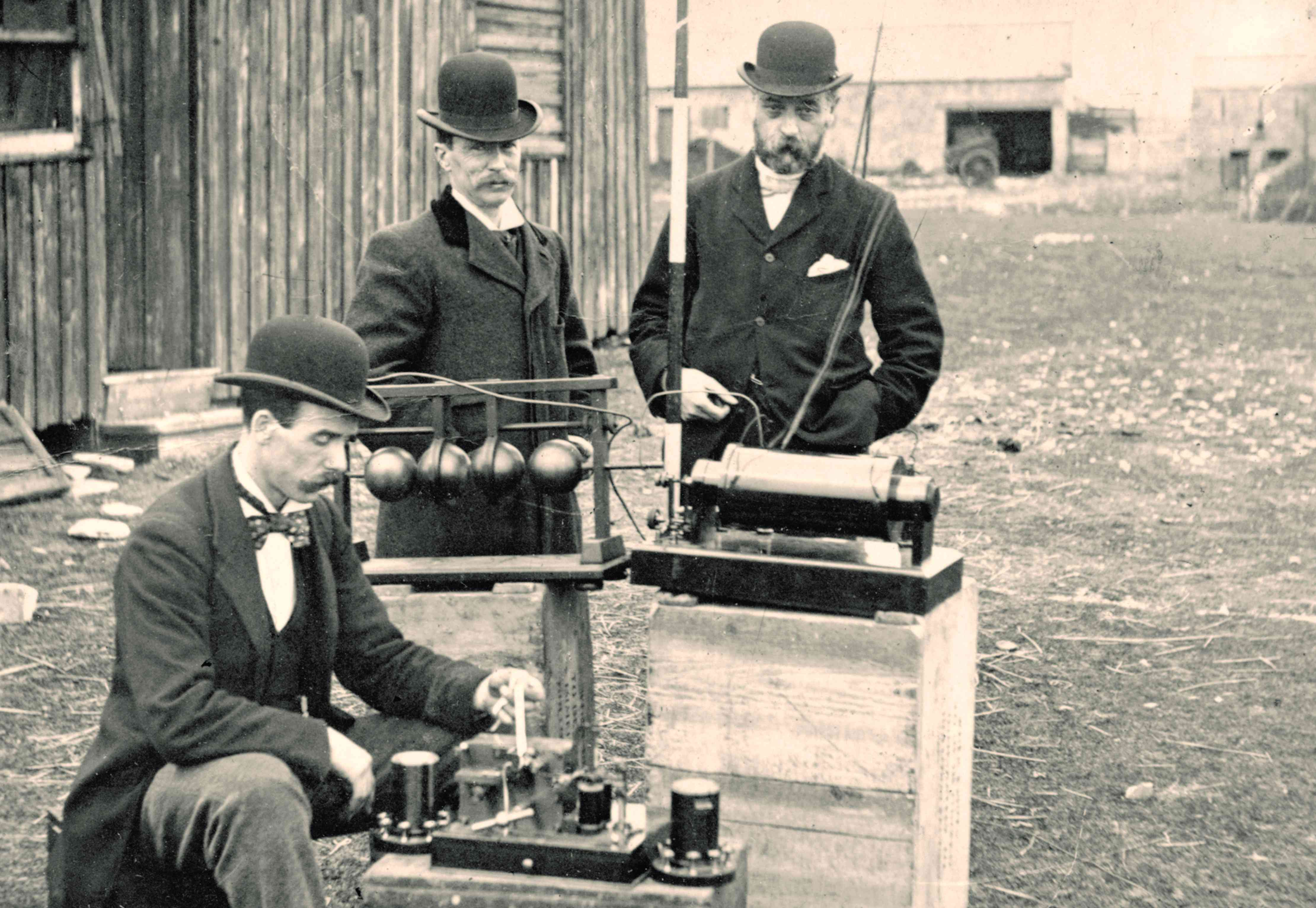 Old photograph of British Post Office engineers inspecting Marconi's radio equipment during a demonstration on Flat Holm Island, May 13, 1897
