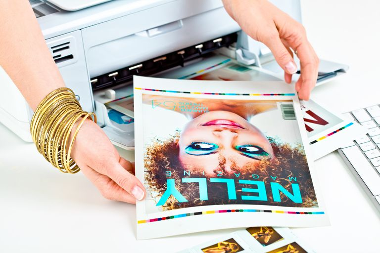 Photo editor holding picture out of printer
