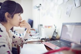 Young girl studing in dormitory