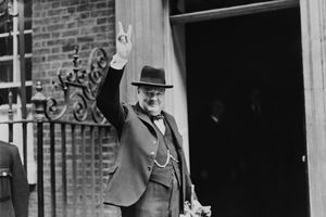 Prime Minister Winston Churchill outside 10 Downing Street, gesturing his famous 'V for Victory' hand signal