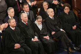 The supreme court justices seated together in Congress.