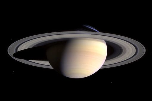 The planet Saturn and its moons and rings.