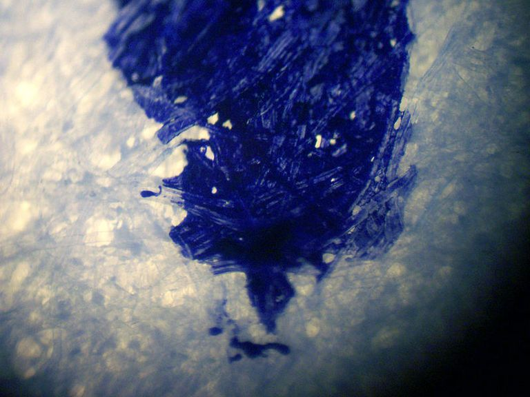 This is a magnified view of blue ink on paper. Prussian blue in is one of the easiest homemade recipes for ink.