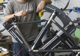 Man assembling a carbon fiber bike frame