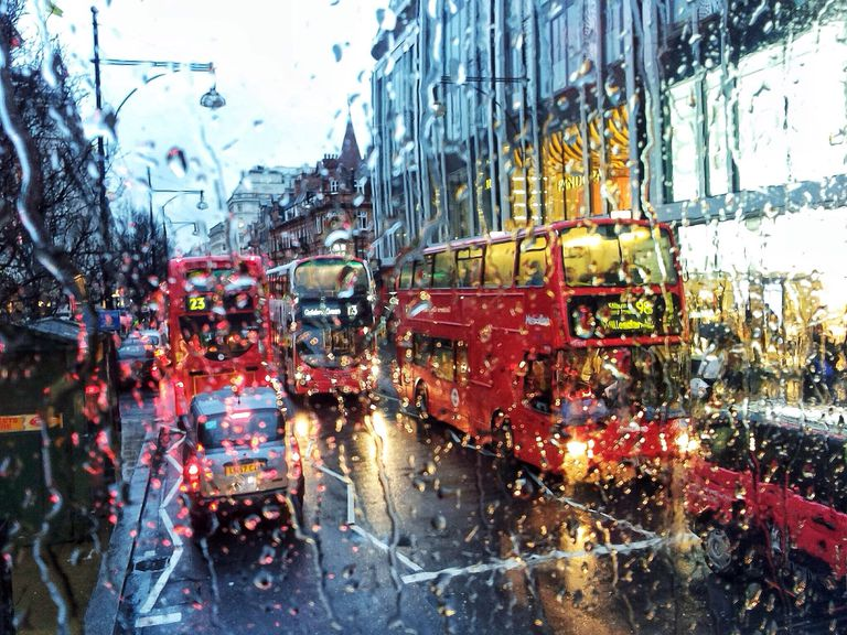 View of London traffic through wet window