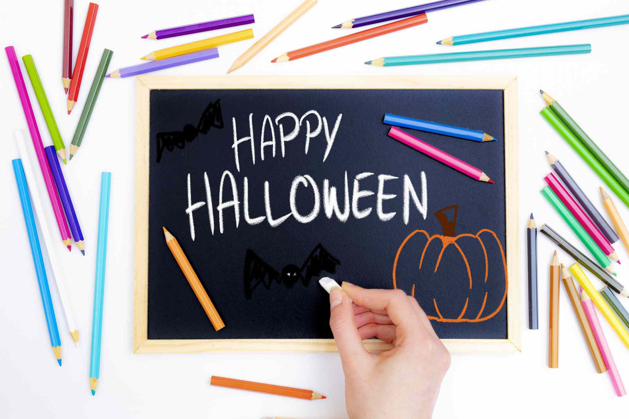 Hand drawing Halloween wishes black board