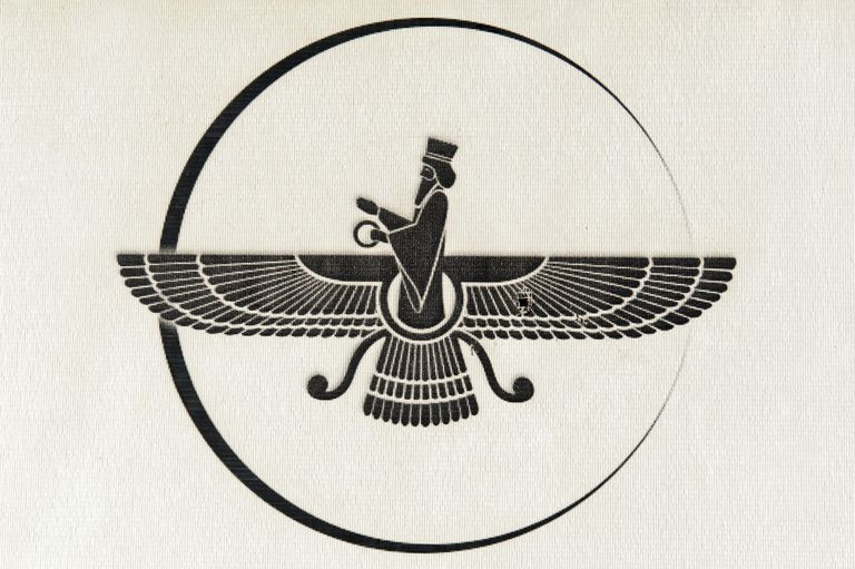 Symbol of Zoroastrianism, Faravahar, printed on a piece of fabric.